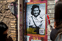 Elsa Oliva, WWII Italian Partizans, Member of the Italian Resistance (Please check the QR Code to read her Story).<br /> <br /> Rome, Italy. 25th Apr, 2021. Today, to mark the 76th Anniversary of the Italian Liberation from nazi-fascism (Liberazione), Azione Antifascista Roma Est, supported by ANPI Centocelle (National Association of Italian WWII Partizans), and various Antifascist organizations, movements, students, political parties, social centres, held a march (Corteo) from Piazza delle Camelie to Villa Gordiani's Park (1.), in Centocelle's district. The demonstration began with a rally in front of the Memorial dedicated to the Partizans of Centocelle victims of nazi-fascist occupation troops and retaliations, where Partizans and their relatives, activists, historians gave speeches to remember the population struggle and solidarity, to keep the memory and the lesson of the Resistenza alive and to reaffirm the values of Freedom and Justice of the Italian Antifascist Constitution as the only way to fight against fascist pulsions re-appearing all over the world.  <br /> On the 4th June 2018 the Centocelle's District was awarded of the State Gold Medal (for Civil Merit) for its Antifascist Resistance (2.).<br /> <br /> Footnotes & Links: <br /> 1. http://bit.do/fQB69 <br /> 2. http://bit.do/fQB7m <br /> Previous 25 Aprile's Events:<br /> - 25 Aprile 2020: http://bit.do/fQB77 <br /> - I Partigiani http://tiny.cc/cwi3nz<br /> - 25 Aprile 2019 (at Ferramonti di Tarsia concentration camp) http://bit.do/fQB8i <br /> - 25 Aprile 2018 http://tiny.cc/dsi3nz<br /> http://www.anpi.it <br /> (Source, Wikipedia.org ENG) The Liberazione: https://en.wikipedia.org/wiki/Liberation_Day_(Italy)