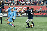 FOXBOROUGH, MA - SEPTEMBER 29: Tony Rocha #15 of New York City FC slides to block a shot on goal by Cristian Penilla #70 of New England Revolution during a game between New York City FC and New England Revolution at Gillettes Stadium on September 29, 2019 in Foxborough, Massachusetts.