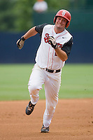Jimmy Brennan #24 of the St. John's Red Storm hustles towards third base against the Ole Miss Rebels at the Charlottesville Regional of the 2010 College World Series at Davenport Field on June 6, 2010, in Charlottesville, Virginia.  The Red Storm defeated the Rebels 20-16.  Photo by Brian Westerholt / Four Seam Images