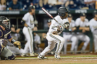 Vanderbilt Commodores designated hitter Ro Coleman (1) follows through on his swing against the TCU Horned Frogs in Game 12 of the NCAA College World Series on June 19, 2015 at TD Ameritrade Park in Omaha, Nebraska. The Commodores defeated TCU 7-1. (Andrew Woolley/Four Seam Images)