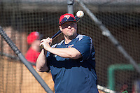 Shippensburg Raiders head coach Matt Jones its fungos prior to the game against the Belmont Abbey Crusaders at Abbey Yard on February 8, 2015 in Belmont, North Carolina.  The Raiders defeated the Crusaders 14-0.  (Brian Westerholt/Four Seam Images)