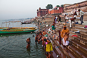 Religious Hindu pilgrims offers prayers and take a bath at dawn on the ghats of Ganges in the ancient city of Varanasi in Uttar Pradesh, India. Photograph: Sanjit Das/Panos