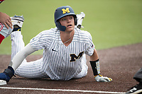 Michigan Wolverines shortstop Benjamin Sems (2) dives back to first base during NCAA baseball action against the Ohio State Buckeyes on April 10, 2021 at Ray Fisher Stadium in Ann Arbor, Michigan. The Wolverines defeated the Buckeyes 7-0. (Andrew Woolley/Four Seam Images)