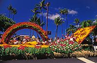 Aunties waving from a colorful float at the  aloha week parade in Waikiki along Kalakaua avenue