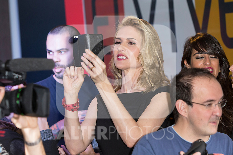 Spanish model Judit Masco takes a picture with her phone during promotional event in Madrid, Spain. February 11, 2016. (ALTERPHOTOS/Victor Blanco)