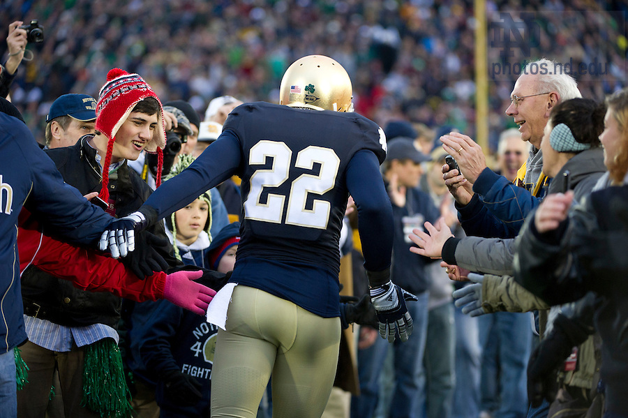 November 19, 2011; Notre Dame Fighting Irish safety Harrison Smith is greeted by fans as he runs onto the field before the game against the Boston College Eagles. Photo by Barbara Johnston/University of Notre Dame.