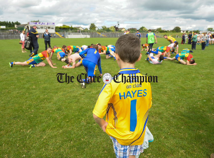 Young Darragh Hayes looks on as his dad and Clare goalie Joe Hayes warms down following their All-Ireland senior championship round 2B win at Dr. Cullen park. Photograph by John Kelly.