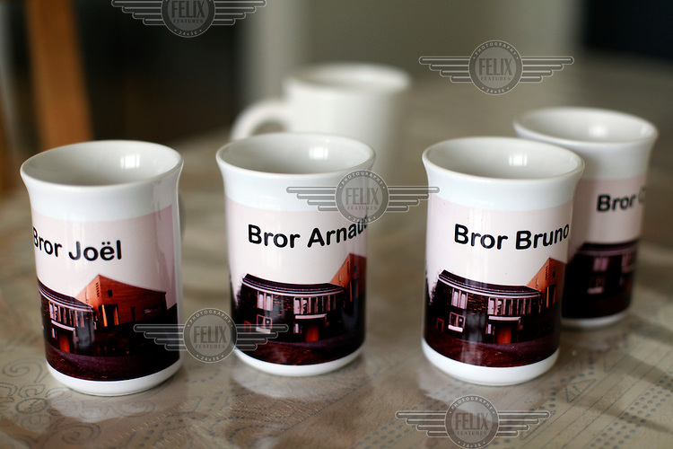 """Coffee mugs given to the brothers by their neighbours. ..The new Munkeby Mariakloster - kloster is Norwegian for monastery . The four founding French monks will establish their discrete presence as a contemplative monastery according to the Rule of Saint Benedict, written in the 6th century. Brother Joel (55) & Cîteaux's Prior, brothers Arnaud (31), Bruno (33) and Cyril (81), have all chosen to be part of the founding community, despite Norway's rude climate and winter darkness at latitude 63º N, not far from the arctic circle.Munkeby, the """"place of the monks"""" was the third and northernmost Norwegian monastery established by the Cistercians in the 12th century"""