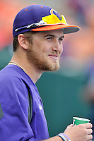 Pitcher Clate Schmidt (32) of the Clemson University Tigers talks in the dugout during a game against the Wofford College Terriers on Tuesday, March 1, 2016, at Doug Kingsmore Stadium in Clemson, South Carolina. Clemson won, 7-0. (Tom Priddy/Four Seam Images)