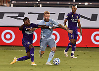 KANSAS CITY, KS - SEPTEMBER 23: #8 Jhegson Mendez of Orlando City SC attempts to stall #7 Johnny Russell of Sporting Kansas City drive upfield as #17 Nani of Orlando City SC looks on during a game between Orlando City SC and Sporting Kansas City at Children's Mercy Park on September 23, 2020 in Kansas City, Kansas.
