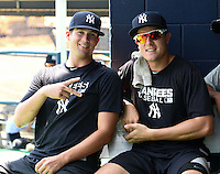 GCL Yankees 1 Matt Marsh and Adam Silva (with glasses) during the first game of a doubleheader against the GCL Braves on July 1, 2014 at the Yankees Minor League Complex in Tampa, Florida.  GCL Yankees 1 defeated the GCL Braves 7-1.  (Mike Janes/Four Seam Images)