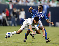 Carlos Palacios (14) trips up Brian Ching (11).  The US Men's National Team defeated Honduras 2-0 in the semifinals of the Gold Cup at Soldier Field in Chicago, IL on July 23, 2009.
