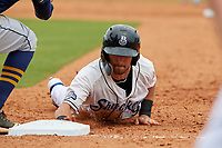 Biloxi Shuckers Cooper Hummel (9) dives back to first base during a Southern League game against the Montgomery Biscuits on May 8, 2019 at MGM Park in Biloxi, Mississippi.  Biloxi defeated Montgomery 4-2.  (Mike Janes/Four Seam Images)