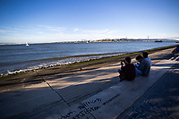LISBON, PORTUGAL - June 8: A person takes a picture with his cellphone at a riverside walk in Lisbon, on June 8, 2021. <br /> Tourists anticipated trips from Lisbon to the U.K. They decided to return early so they wouldn't have to quarantine. since the new rules were announced for those traveling from Portugal to the UK. <br /> (Photo by Luis Boza/VIEWpress)