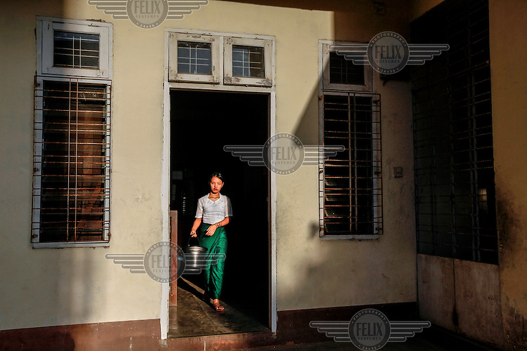 A girl fetches water at the Mary Chapman school for deaf children in Yangon.