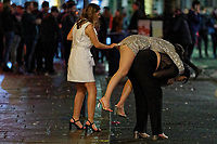 Pictured: A young woman attempts to ride piggy back in Wind Street, Swansea, Wales, UK. Friday 20 December 2019<br /> Re: Black Eye Friday (also known as Black Friday, Mad Friday, Frantic Friday) the last Friday before Christmas, in Swansea, Wales, UK.