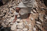 A man walks on his destroyed house. Outskirt of Kathmandu, Nepal. May 11, 2015