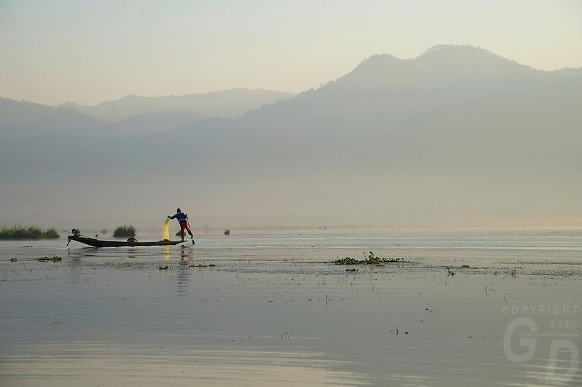 Traditional Fisherman on Inle Lake at sunrise, Shan State Myanmar/Burma