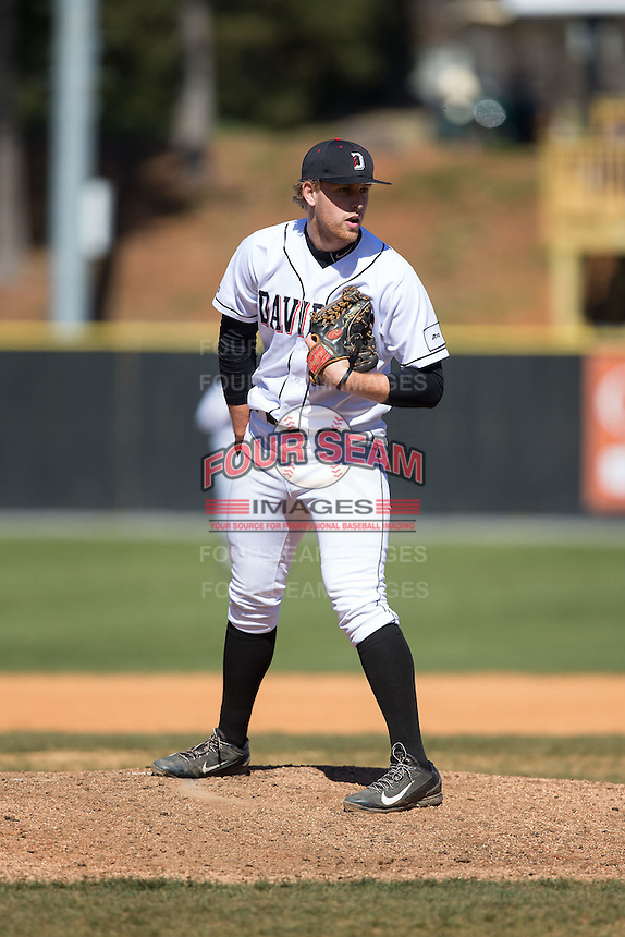Davidson Wildcats relief pitcher Brian Fortier (28) looks to his catcher for the sign against the Saint Louis Billikens at Wilson Field on March 28, 2015 in Davidson, North Carolina. (Brian Westerholt/Four Seam Images)