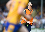 Donal Moloney, Clare joint manager, runs across the field after delivering instructions to players during their Munster  championship round robin game at Cusack Park Photograph by John Kelly.