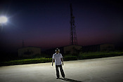 Chinese workers are seen playing at dawn at the Chinese Colony in the Adani Power plant in Mundra port industrial city of Gujarat, India. Indian power companies have handed out dozens of major contracts to Chinese firms since 2008. Adani Power Ltd have built elaborate Chinatowns to accommodate Chinese workers, complete with Chinese chefs, ping pong tables and Chinese television. Chinese companies now supply equipment for about 25% of the 80,000 megawatts in new capacity.
