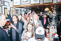 People crowd around the door as Republican presidential candidate Donald Trump enters  Red Arrow Diner in Manchester, New Hampshire.