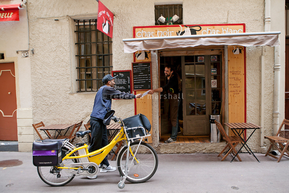 The postman hands chef Nicolas Sikic his mail at restaurant 'Chat Noir, Chat Blanc', Nice, France, 10 April 2012