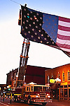 A fire truck ladder squad provdes a lift in hanging the flag before the Quad Cities Marathon 2009<br /> This  Edition is Limited to 50 Prints on Premium Canvas. Each print comes with a signed Certificate of Authenticity. Print sizes refer to the longest dimension.