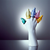 Hand sculpture with condoms