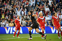 USWNT forwrad Abby Wambach turns away after scoring from a penalty.....USWNT played to a 1-1 tie with Canada at LIVESTRONG Sporting Park, Kansas City, Kansas.