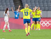 TOKYO, JAPAN - JULY 21: Lina Hurtig #8 of Sweden celebrates her goal with Amanda Ilestedt #11 during a game between Sweden and USWNT at Tokyo Stadium on July 21, 2021 in Tokyo, Japan.