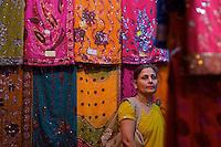 Women buying sari Varanasi Ganges India