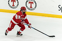 WORCESTER, MA - FEBRUARY 08: Grace Parker #20 of Boston University brings the puck forward during a game between Boston University and College of the Holy Cross at Hart Center Rink on February 08, 2020 in Worcester, Massachusetts.