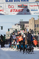 Charley Bejna and team leave the ceremonial start line with an Iditarider at 4th Avenue and D street in downtown Anchorage, Alaska on Saturday March 2nd during the 2019 Iditarod race. Photo by Brendan Smith/SchultzPhoto.com