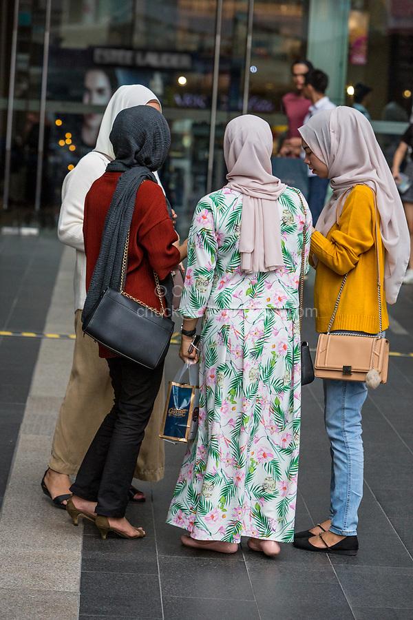 Malaysian Women Wearing Traditional and Modern Western Casual Style Clothing, Pavilion Mall, Kuala Lumpur, Malaysia.