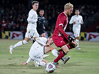 COLLEGE PARK, MD - NOVEMBER 15: Matt Di Rosa #27 of Maryland slides the ball away from Simon Waever #3 of Indiana during a game between Indiana University and University of Maryland at Ludwig Field on November 15, 2019 in College Park, Maryland.