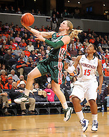 Jan. 6, 2011; Charlottesville, VA, USA; Miami Hurricanes guard Stefanie Yderstrom (3) shoots the ball in front of Virginia Cavaliers guard Ariana Moorer (15) during the game at the John Paul Jones Arena.  Mandatory Credit: Andrew Shurtleff-
