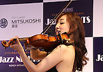 July 1, 2016, Tokyo, Japan - Japanese violinist Junko Makiyama plays violin for a jazz session with Japanese pianist Riyoko Takagi at the Mitsukoshi department store in Tokyo's Ginza district on Friday, July 1, 2016. Their public recording of FM broadcasting will be on air on July 24.  (Photo by Yoshio Tsunoda/AFLO) LWX -ytd-