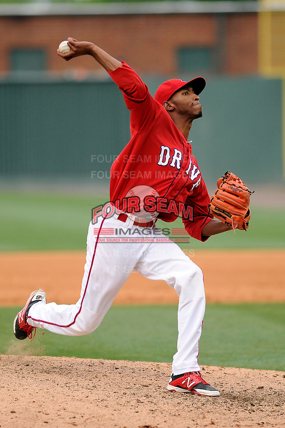 Relief pitcher Sergio Gomez (13) of the Greenville Drive in a game against the Lexington Legends on Sunday, April 27, 2014, at Fluor Field at the West End in Greenville, South Carolina. Greenville won, 21-6. (Tom Priddy/Four Seam Images)