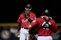 Billings Mustangs relief pitcher Jeffry Nino (45) talks to Valentin Martinez (46) during a Pioneer League game against the Grand Junction Rockies at Dehler Park on August 15, 2019 in Billings, Montana. Billings defeated Grand Junction 11-2. (Zachary Lucy/Four Seam Images)