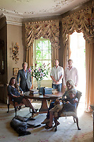 Members of the Roper-Curzon family and their two dogs in the drawing room