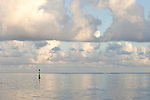 Moorea, French Polynesia; sunrise view of a green channel marker buoy, from an abandoned, broken down pier , Copyright © Matthew Meier, matthewmeierphoto.com All Rights Reserved