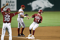Arkansas outfielder Braydon Webb (8) runs to third, Saturday, June 5, 2021 during the fourth inning in the second game of the NCAA Fayetteville Regional at Baum-Walker Stadium in Fayetteville. Check out nwaonline.com/210606Daily/ for today's photo gallery. <br /> (NWA Democrat-Gazette/Charlie Kaijo)