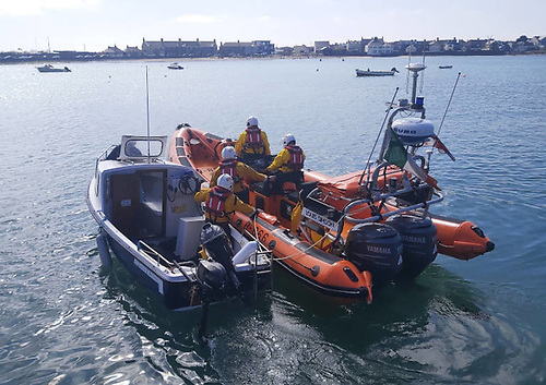 Skerries RNLI towing the stricken motorboat to safety