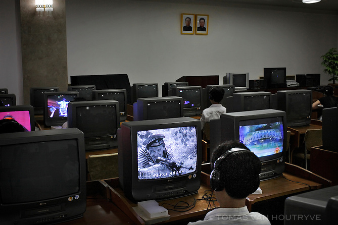Students watch television screens inside the Great People's Study House in Pyongyang, North Korea (DPRK) on 16 August 2007.
