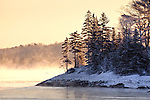 A winter sunrise on the Taunton River in Hancock, ME, USA