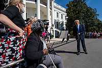 United States President Donald J. Trump speaks to the media as he walks to Marine One on the South Lawn of the White House on Thursday, October 15, 2020. Trump will deliver remarks at a Fundraising Committee Reception in Doral, FL<br /> and participate in a Live NBC News Town Hall Event.   <br /> CAP/MPI/RS<br /> ©RS/MPI/Capital Pictures