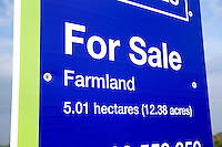 Field sign advertising land for sale