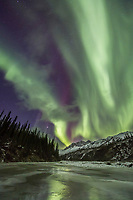 The aurora borealis lights the nights sky in Alaska's Brooks Range, Arctic, Alaska