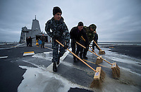 130430-N-DR144-492 Pacific Ocean (April 30, 2013)- Air Department Sailors aboard San Antonio-class amphibious transport dock ship USS Anchorage (LPD 23) scrub the flight deck as the ship approaches the Alaska coast. Anchorage is currently en route to its namesake city of Anchorage, Alaska for its commissioning ceremony May 4. (U.S. Navy photo by Mass Communication Specialist 1st Class James R. Evans / RELEASED)